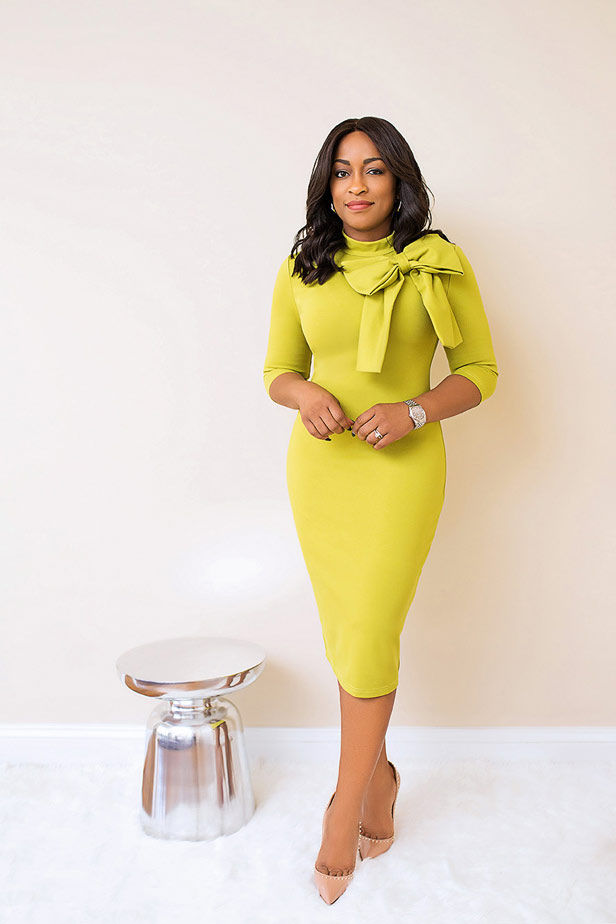 Yellow Jackie dress with large bow at neck.